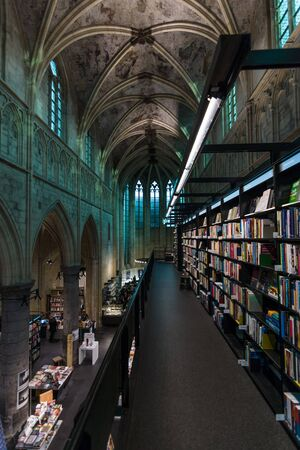 MAASTRICHT, NETHERLANDS - JANUARY 13, 2016: Dominican Church of the 13th century, after the restoration in 2005 using the premises as a bookstore.