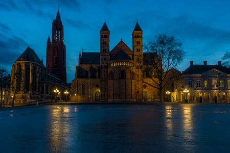 evangelical: St. Johns Evangelical Church Sint Janskerk and the Basilica of Saint Servatius right at Vrijthof Square. Evening light. Maastricht, The Netherlands Stock Photo