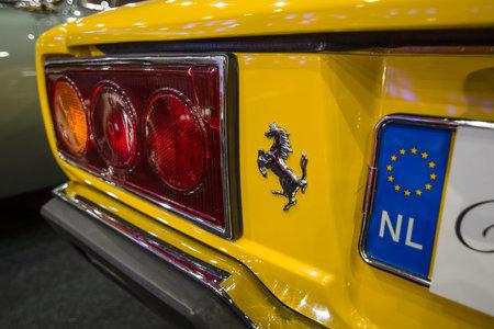 stoplights: MAASTRICHT, NETHERLANDS - JANUARY 14, 2016: The rear brake lights of a sports car Ferrari 308 GT4 Dino, 1977. International Exhibition InterClassics & Topmobiel 2016