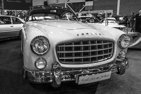 bodywork: MAASTRICHT, NETHERLANDS - JANUARY 14, 2016: Sports car Ford Comete, 1953. Bodywork was built by FACEL. Black and white. International Exhibition InterClassics & Topmobiel 2016