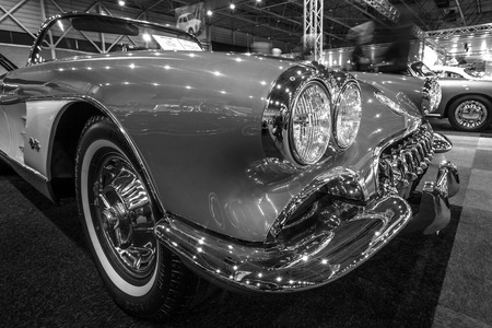 cultic: MAASTRICHT, NETHERLANDS - JANUARY 14, 2016: Detail of a sports car Chevrolet Corvette (C1), 1960. Black and white. International Exhibition InterClassics & Topmobiel 2016