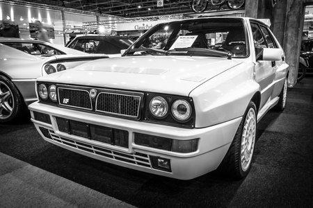 hf: MAASTRICHT, NETHERLANDS - JANUARY 14, 2016: Sports car Lancia Delta HF Integrale 16v Evoluzione II, 1993. Black and white. International Exhibition InterClassics & Topmobiel 2016 Editorial