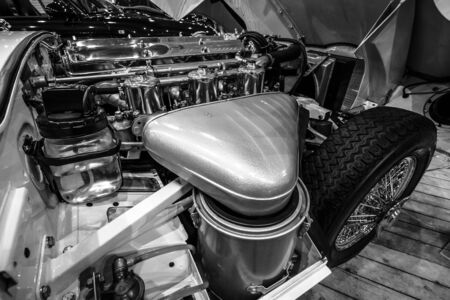 engine compartment: MAASTRICHT, NETHERLANDS - JANUARY 14, 2016: Engine compartment Jaguar E-Type Series 1 coupe, 1963. Black and white. International Exhibition InterClassics & Topmobiel 2016