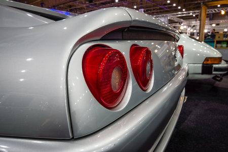 stoplights: MAASTRICHT, NETHERLANDS - JANUARY 14, 2016: Stop lights of sports car Ferrari F355 GTS, 1998. International Exhibition InterClassics & Topmobiel 2016