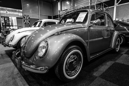 cultic: MAASTRICHT, NETHERLANDS - JANUARY 14, 2016: Subcompact Volkswagen Beetle, 1971. Black and white. International Exhibition InterClassics & Topmobiel 2016 Editorial