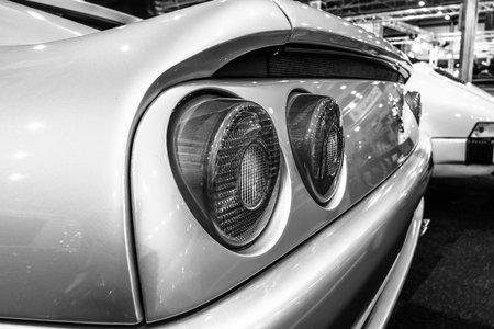 stoplights: MAASTRICHT, NETHERLANDS - JANUARY 14, 2016: Stop lights of sports car Ferrari F355 GTS, 1998. Black and white. International Exhibition InterClassics & Topmobiel 2016