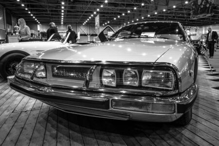 sm: MAASTRICHT, NETHERLANDS - JANUARY 14, 2016: Grand tourer car Citroen SM, 1972. Black and white. International Exhibition InterClassics & Topmobiel 2016 Editorial