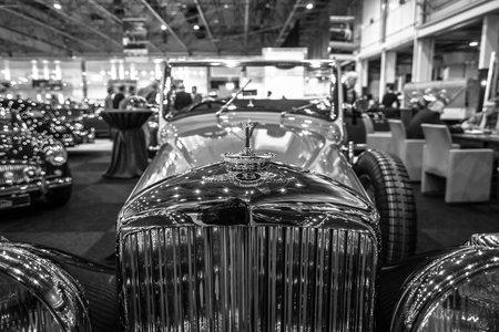litre: MAASTRICHT, NETHERLANDS - JANUARY 14, 2016: Detail of retro car Bentley 4 14 Litre, 1937. Black and white. International Exhibition InterClassics & Topmobiel 2016