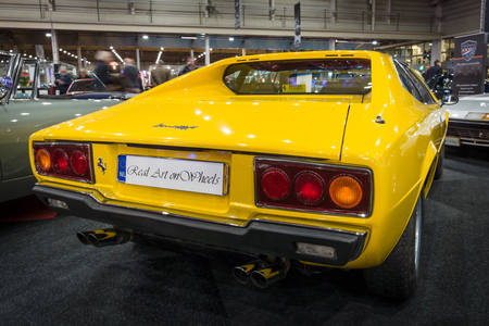 stoplights: MAASTRICHT, NETHERLANDS - JANUARY 14, 2016: Sports car Ferrari 308 GT4 Dino, 1977. Rear view. International Exhibition InterClassics & Topmobiel 2016 Editorial