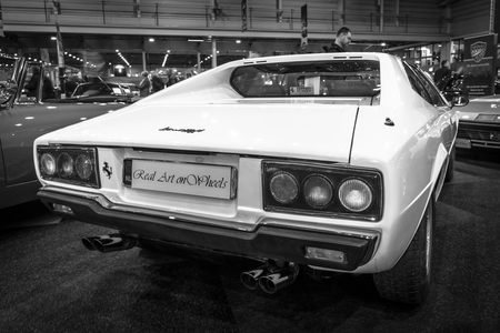 stoplights: MAASTRICHT, NETHERLANDS - JANUARY 14, 2016: Sports car Ferrari 308 GT4 Dino, 1977. Rear view. Black and white. International Exhibition InterClassics & Topmobiel 2016