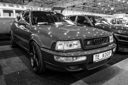 avant: MAASTRICHT, NETHERLANDS - JANUARY 14, 2016: Compact executive car Audi RS 2 Avant, 1989. Black and white. International Exhibition InterClassics & Topmobiel 2016
