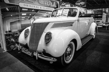 v8: MAASTRICHT, NETHERLANDS - JANUARY 14, 2016: Full-size car Ford V8 convertible, 1937. Black and white. International Exhibition InterClassics & Topmobiel 2016