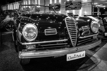 farina: MAASTRICHT, NETHERLANDS - JANUARY 14, 2016: Sports car Alfa Romeo 6C 2500 SS Pinin Farina Cabriolet, 1947. Black white. International Exhibition InterClassics & Topmobiel 2016