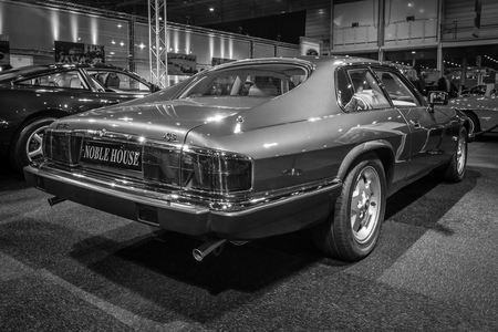 liter: MAASTRICHT, NETHERLANDS - JANUARY 14, 2016: Grand tourer car Jaguar XJS Insignia Coupe, 4.0 Liter Straight Six, 1993. Rear view. Black and white. International Exhibition InterClassics & Topmobiel 2016