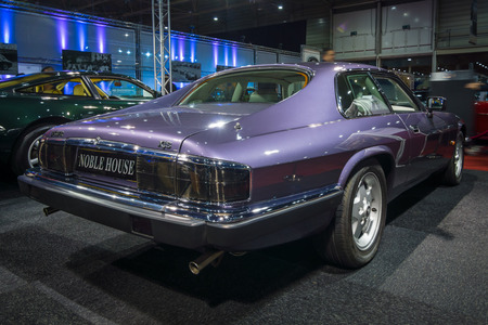 liter: MAASTRICHT, NETHERLANDS - JANUARY 14, 2016: Grand tourer car Jaguar XJS Insignia Coupe, 4.0 Liter Straight Six, 1993. Rear view. International Exhibition InterClassics & Topmobiel 2016 Editorial