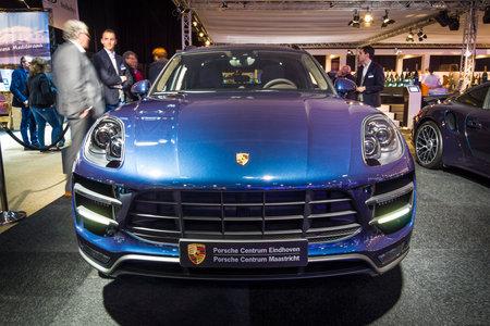crossover: MAASTRICHT, NETHERLANDS - JANUARY 14, 2016: Compact luxury crossover Porsche Macan Turbo. International Exhibition InterClassics & Topmobiel 2016 Editorial