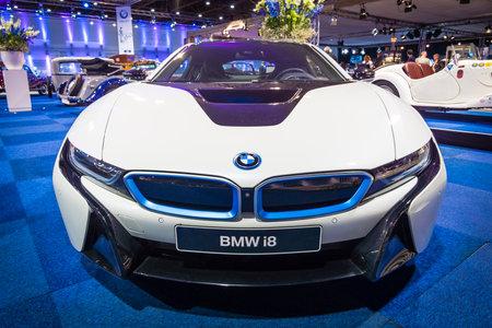 plugin: MAASTRICHT, NETHERLANDS - JANUARY 14, 2016: Plug-in hybrid sports car BMW i8. International Exhibition InterClassics & Topmobiel 2016 Editorial