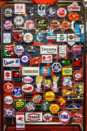 manufacturers: MAASTRICHT, NETHERLANDS - JANUARY 14, 2016: Background of logos from different manufacturers of automotive and motorcycle equipment and machinery. International Exhibition InterClassics & Topmobiel 2016