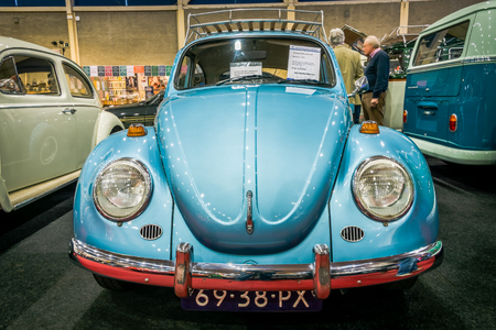 cultic: MAASTRICHT, NETHERLANDS - JANUARY 14, 2016: Compact car Volkswagen Beetle, 1971. International Exhibition InterClassics & Topmobiel 2016 Editorial