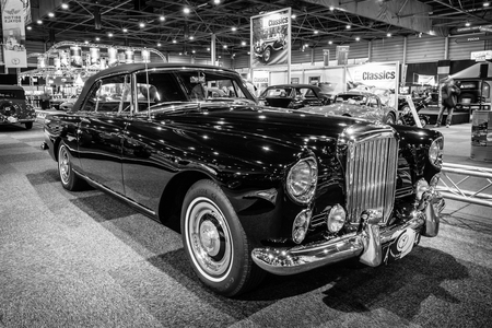 MAASTRICHT, NETHERLANDS - JANUARY 14, 2016: High-performance luxury car Bentley Continental S2 Drophead Coupe by Park Ward, 1963. Black and white. International Exhibition InterClassics & Topmobiel 2016