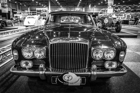 coachwork: MAASTRICHT, NETHERLANDS - JANUARY 14, 2016: Full-size luxury car Bentley T1 Drophead Coupe, 1970. Coachwork by Mulliner Park Ward. Black and white. International Exhibition InterClassics & Topmobiel 2016