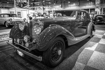 litre: MAASTRICHT, NETHERLANDS - JANUARY 14, 2016: Vintage car Bentley 4 14 Litre Derby Drophead Coupe, 1936. Black and white. International Exhibition InterClassics & Topmobiel 2016