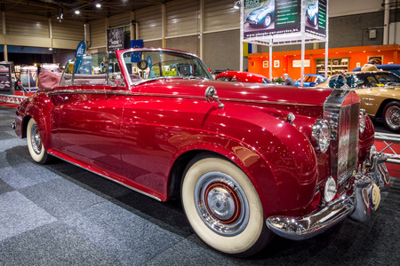 coupe: MAASTRICHT, NETHERLANDS - JANUARY 14, 2016: Luxury car Rolls-Royce Silver Cloud II Drophead Coupe, 1962. International Exhibition InterClassics & Topmobiel 2016