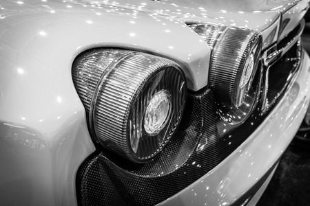ferrari: MAASTRICHT, NETHERLANDS - JANUARY 15, 2016: Stoplight of a sports car Ferrari F430, close-up, 2006. Black and white. International Exhibition InterClassics & Topmobiel 2016