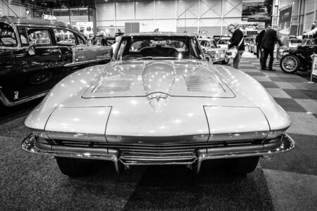 corvette: MAASTRICHT, NETHERLANDS - JANUARY 15, 2016: Sports car Chevrolet Corvette C2 Split Window, 1963. Black and white. International Exhibition InterClassics & Topmobiel 2016 Editorial