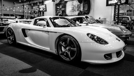 MAASTRICHT, NETHERLANDS - JANUARY 15, 2016: Supercar Porsche Carrera GT, 2005. Black and white. International Exhibition InterClassics & Topmobiel 2016 Editoriali