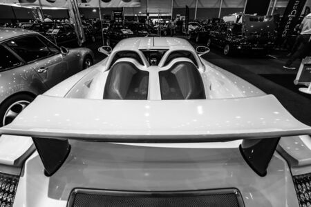 engine compartment: MAASTRICHT, NETHERLANDS - JANUARY 15, 2016: Supercar Porsche Carrera GT, 2005. A view of the engine compartment. International Exhibition InterClassics & Topmobiel 2016