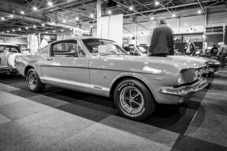 mustang gt: MAASTRICHT, NETHERLANDS - JANUARY 15, 2016: Pony car Ford Mustang GT (first generation), 1965. Black and white. International Exhibition InterClassics & Topmobiel 2016
