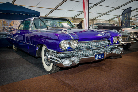 coupe: MAASTRICHT, NETHERLANDS - JANUARY 15, 2016: Full-size luxury car Cadillac Coupe de Ville, 1959. International Exhibition InterClassics & Topmobiel 2016