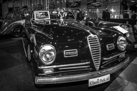 farina: MAASTRICHT, NETHERLANDS - JANUARY 15, 2016: Sports car Alfa Romeo 6C 2500 SS Pinin Farina Cabriolet, 1947. Black and white. International Exhibition InterClassics & Topmobiel 2016