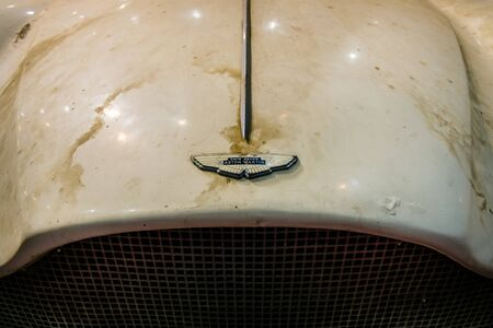 david brown: MAASTRICHT, NETHERLANDS - JANUARY 15, 2016: Detail of a rusty hood and logo sports car Aston Martin DB Mark III. International Exhibition InterClassics & Topmobiel 2016 Editorial