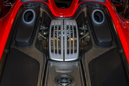 engine compartment: MAASTRICHT, NETHERLANDS - JANUARY 15, 2016: The engine compartment of a hypercar Porsche 918 Spyder. International Exhibition InterClassics & Topmobiel 2016 Editorial