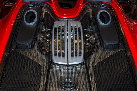 engine compartment: MAASTRICHT, NETHERLANDS - JANUARY 15, 2016: The engine compartment of a hypercar Porsche 918 Spyder. International Exhibition InterClassics & Topmobiel 2016 Editorial