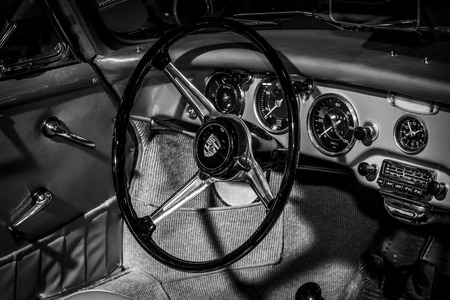 speedster: MAASTRICHT, NETHERLANDS - JANUARY 15, 2016: Cabin of sports car Porsche 356A Speedster, 1955. Black and white. International Exhibition InterClassics & Topmobiel 2016 Editorial