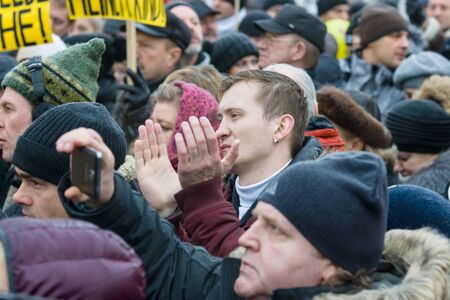protesting: BERLIN - JANUARY 23, 2016: Russian Diaspora in Berlin protesting against migrants and refugees due to the sexual abuse of women and children. Editorial