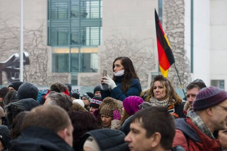 diaspora: BERLIN - JANUARY 23, 2016: Russian Diaspora in Berlin protesting against migrants and refugees due to the sexual abuse of women and children. Editorial