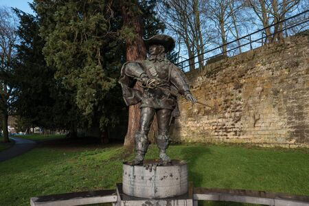 musketeer: MAASTRICHT, NETHERLANDS - JANUARY 16, 2016: Statue of dArtagnan. The famous musketeer, in the time of Louis XIV of France described in the novel by Alexandre Dumas The Three Musketeers