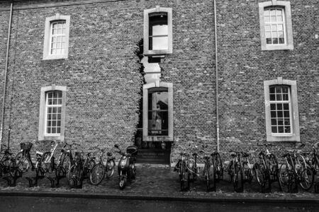 limburg: MAASTRICHT, NETHERLANDS - JANUARY 16, 2016: Old streets in the historic center. Partially ruined facade. Black and white. Maastricht is the oldest city of the Netherlands and the capital city of the province of Limburg.