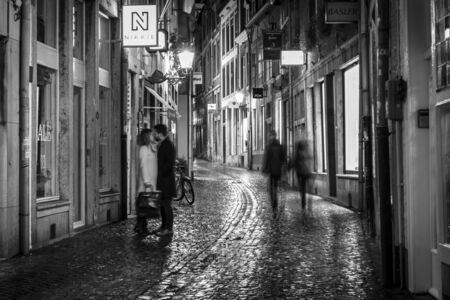 limburg: MAASTRICHT, NETHERLANDS - JANUARY 16, 2016: Street in the evening lights in the historic center. Black and white. Maastricht is the oldest city of the Netherlands and the capital city of the province of Limburg.