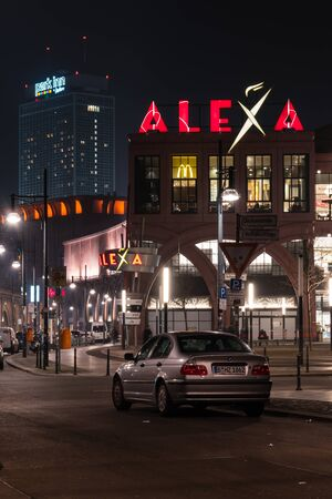 BERLIN - MARCH 05, 2016: Shopping center Alexa on Alexanderplatz in the evening illumination. Alexa is the second largest (56.200 square meters) shopping center in Berlin.