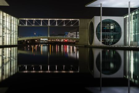 spree: BERLIN - MARCH 05, 2016: The complex of buildings in the government quarter (Regierungsviertel). Marie-Elisabeth-Lueders-Haus and Spree river at night.