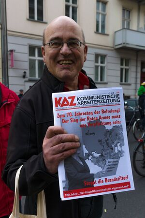 distributor: BERLIN - MAY 01, 2015: International Labour Day. Distributor of Communist newspapers.