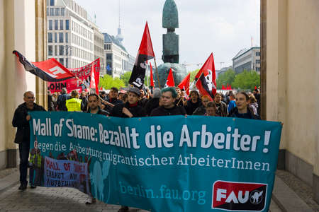 demonstrators: BERLIN - MAY 01, 2015: International Labour Day. Demonstrators near the Brandenburg Gate.
