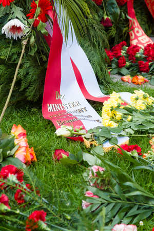 minister of war: BERLIN - MAY 08, 2015: Victory in Europe Day. Treptower Park. Wreath of flowers from the prime minister of Brandenburg. Sculpture Motherland.