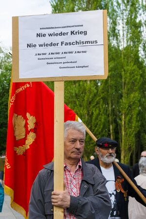 fascism: BERLIN - MAY 08, 2015: Victory in Europe Day. Treptower Park. Communist activists at the memorable event. Text in German: No War! No fascism!