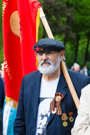 activists: BERLIN - MAY 08, 2015: Victory in Europe Day. Treptower Park. Communist activists in the commemorative event